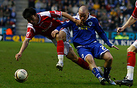Photo: Steve Bond/Sportsbeat Images.<br />Leicester City v Charlton Athletic. Coca Cola Championship. 29/12/2007. Zheng Zhi (L) and Iain Hume (R) tussle for the ball