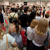 MILAN, ITALY - JUNE 11:  Customer queue in front of the Gucci stand the day of the opening to the public of the 10th Convivio on June 11, 2010 in Milan, Italy. Convivio is Italy's most high profile charity sale to raise money for ANLAIDS the national association for the fight against AIDS  (Photo by Marco Secchi/Getty Images)
