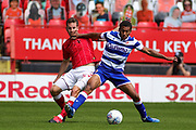 Reading midfielder Andy Rinomhota (8) tussles with Charlton Athletic defender Tom Lockyer (5) during the EFL Sky Bet Championship match between Charlton Athletic and Reading at The Valley, London, England on 11 July 2020.