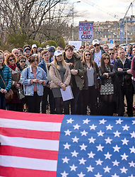 Pictured: Ellie Crozier, (centre) who's sister Emma died in the Dunblane shooting, listens to the speakers.<br /> <br /> Protesters demonstrated outside the US Consulate in Edinburgh in support of the 'March for our Lives' movement in America, calling for gun control in the wake of recent high school shootings. Protesters were joined by relatives of victims of the Dunblane shooting.<br /> <br /> © Dave Johnston / EEm