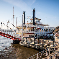 Picture of Spirit of Peoria Riverboat in Peoria Illinois. Built in 1988, the Spirit of Peoria paddlewheel is used  for propusion and carries passengers along the Illinois River.