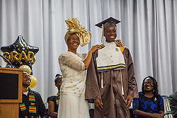 Commencement speaker and teacher Mrs. Beverley Shillingford holds up the sailor suit that Malaki Charles and other students liked to wear as kindergartners.  St. Thomas/St. John Seventh Day Adventist School Commencement Service.  Bertha C. Boschulte Auditorium.  St. Thomas, USVI.  12 June 2016.  © Aisha-Zakiya Boyd