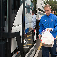 St Johnstone FC depart McDiarmid Park in Perth for the William Hill Scottish Cup Final....16.05.15<br /> Steven Anderson boards the coach with cakes after losing last weeks competition as the team head for their hotel in Glasgow.<br /> Picture by Graeme Hart.<br /> Copyright Perthshire Picture Agency<br /> Tel: 01738 623350  Mobile: 07990 594431