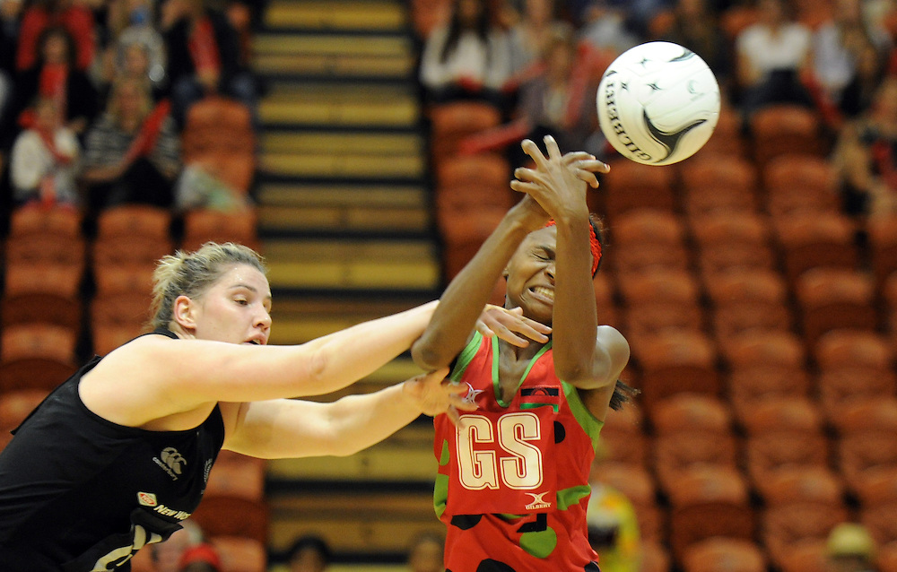 New Zealands' Te Huinga Reo Selby-Rickit, left, contests the ball with Malawis' Mwai Kumwenda in the International Netball test at Pettigrew Green Arena, Napier, New Zealand, Sunday, October 27, 2013. Credit:SNPA / Ross Setford