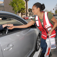 American Red Cross of Santa Monica volunteer Dana Johnson collects donations during their &quot;Drive Through&quot; Japan earthquake/tsunami fundraiser on Fri, March 18, 2011.<br /> <br /> The American Red Cross is working with the Japanese Red Cross (JRC) to insure donations and services make a positive impact on those lives affected by this disaster. The Japanese Red Cross is a highly experienced disaster relief organization with 2-million volunteers. JRC volunteers in Japan are distributing relief items, making sure displaced people are offered hot meals, clearing debris and providing medical transportation. The Japanese Red Cross has also deployed 95 medical teams, made up of more than 700 people, including doctors and nurses.<br />  <br /> The American Red Cross and Japanese Red Cross are members of the International Red Cross and Red Crescent Movement. The American Red Cross assisted the Japanese Red Cross during the Kobe earthquake in 1995, and it, in turn, supported the American Red Cross after September 11 and Hurricane Katrina.<br /> <br /> In addition to the &quot;drive through,&quot; the donors can text REDCROSS to 90999 to make a $10 donation.<br /> Personal checks should be made out to American Red Cross &quot;Japan Earthquake and Pacific Tsunami.&quot; Checks can be mailed or checks or cash can be dropped by the chapter at 1450 11th Street, Santa Monica 90401 anytime during regular business hours. <br /> <br /> The American Red Cross of Santa Monica is a publicly supported, 501(C)(3) nonprofit corporation  that provides health and safety education, youth services, CPR and first aid training, disaster awareness and disaster relief efforts.  For additional information or to inquire about other programs or assistance call 310-394-3773 or go online at www.redcrossofsantamonica.org.