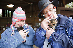 People with learning disability holding kittens at farm
