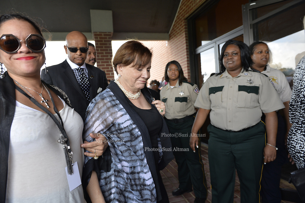 "5/30/15 Indianola, BB Kings wife, center,is seen lentering the church for the funeral service of BB King. Fans to see B. B Kings final home coming funeral procession outside the BB King Museum. A family member reaches out to touch the casket for one last time at the gravesite of Mr. King during the burial outside in the rain. The Thrill is gone, the casket holding the body of BB King arrives at the Bell Grove Missionary Baptist Church for his final homecoming. Blues legend B.B. King is is laid to rest in the shadow of the cotton gin at the B.B. King Museum and Interpretive Center. Mr King's final homecoming procession included a black horse WITH A saddle flanked with two of BB's famous ""Lucielle"" guitars signed by Mr. King. Fans lined the streets to watch the procession and pay their respect to the King of the Blues. Photo ©Suzi Altman"