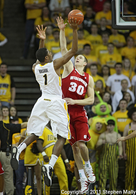 February 09 2011: Iowa Hawkeyes forward Melsahn Basabe (1) puts up a shot as Wisconsin Badgers forward Jon Leuer (30) defends during the first half of an NCAA college basketball game at Carver-Hawkeye Arena in Iowa City, Iowa on February 9, 2011. Wisconsin defeated Iowa 62-59.