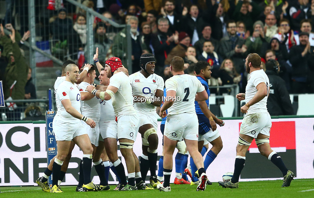 RBS 6 Nations Championship Round 5, Stade de France, Paris, France 19/3/2016<br /> France vs England<br /> England's Dylan Hartley celebrates with try scorer Anthony Watson<br /> Mandatory Credit &copy;INPHO/James Crombie