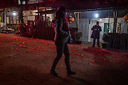 A street is littered with the exploded remains of firecrackers after lunar new year in Mt. Jizu, Yunan, China.