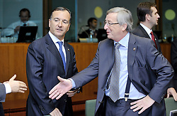 Jean-Claude Juncker, Luxembourg's prime minister, speaks with Franco Frattini, Italy's foreign minister, during the European Summit, Thursday, Oct. 29, 2009 in Brussels. (Photo © Jock Fistick)