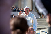 Pope Francis blesses the faithfuls at the end of his weekly general audience in Saint Peter's Square at the Vatican on November 8, 2017.
