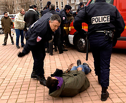 CALAIS, FRANCE  - DEC-10-2002 - Police arrest refugees who were forced to leave the Sangatte refugee camp and were staging a demonstration in the city center of Calais. (PHOTO © JOCK FISTICK)