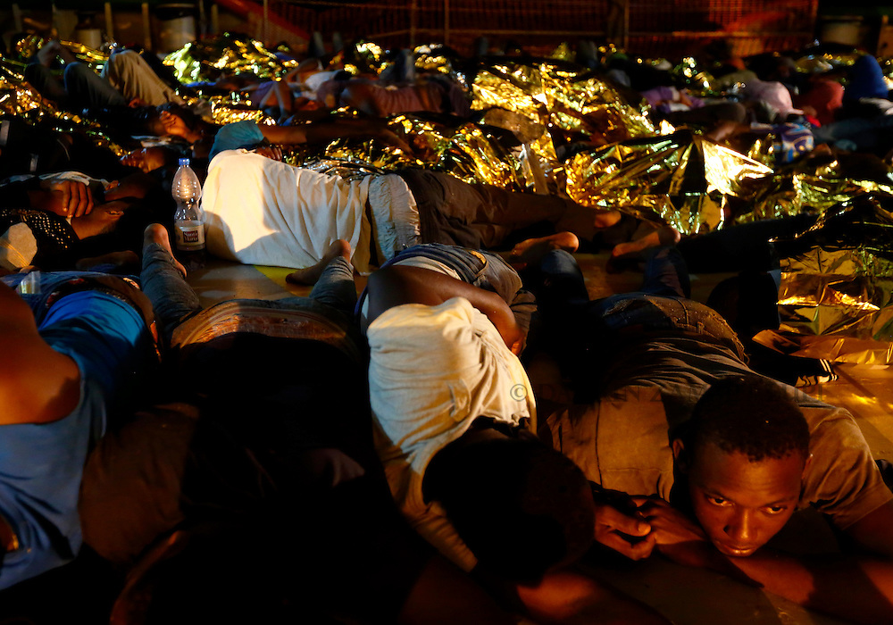 Migrants sleep on the deck of the Medecins san Frontiere (MSF) ship Bourbon Argos off the coast of Libya late August 7, 2015.  Some 241 mostly West African migrants on the ship are expected to arrive on the Italian island of Sicily on Sunday, according to MSF.<br /> REUTERS/Darrin Zammit Lupi <br /> MALTA OUT. NO COMMERCIAL OR EDITORIAL SALES IN MALTA