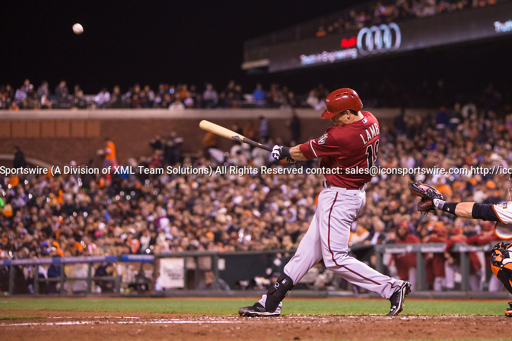 September 10, 2014:  Jake Lamb (19) of the Arizona Diamondbacks at bat and connecting with he ball, during the game between the San Francisco Giants and the Arizona Diamondbacks at AT&T Park in San Francisco, California, USA.