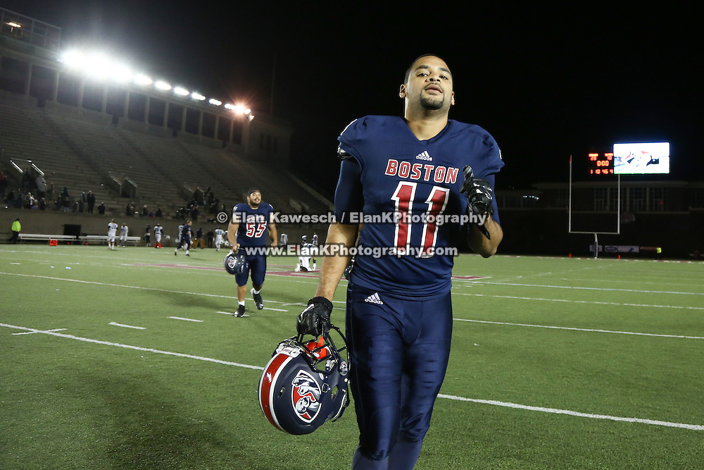 Jasper Collins #11 of the Boston Brawlers runs off the field following the first ever Boston Brawlers home game at Harvard Stadium on October 24, 2014 in Boston, Massachusetts. (Photo by Elan Kawesch)