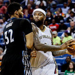 Mar 19, 2017; New Orleans, LA, USA; New Orleans Pelicans forward DeMarcus Cousins (0) drives past Minnesota Timberwolves center Karl-Anthony Towns (32) during the second half of a game at the Smoothie King Center. The Pelicans defeated the Timberwolves 123-109. Mandatory Credit: Derick E. Hingle-USA TODAY Sports