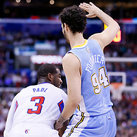 15 April 2014: Denver Nuggets guard Evan Fournier (94) defends on Los Angeles Clippers guard Chris Paul (3) during the Los Angeles Clippers 117-105 victory over the Denver Nuggets at the Staples Center, Los Angeles, California, USA.