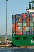 Detail of containers cargo ship at Miraflores Locks. Panama Canal, Panama City, Panama, Central America.