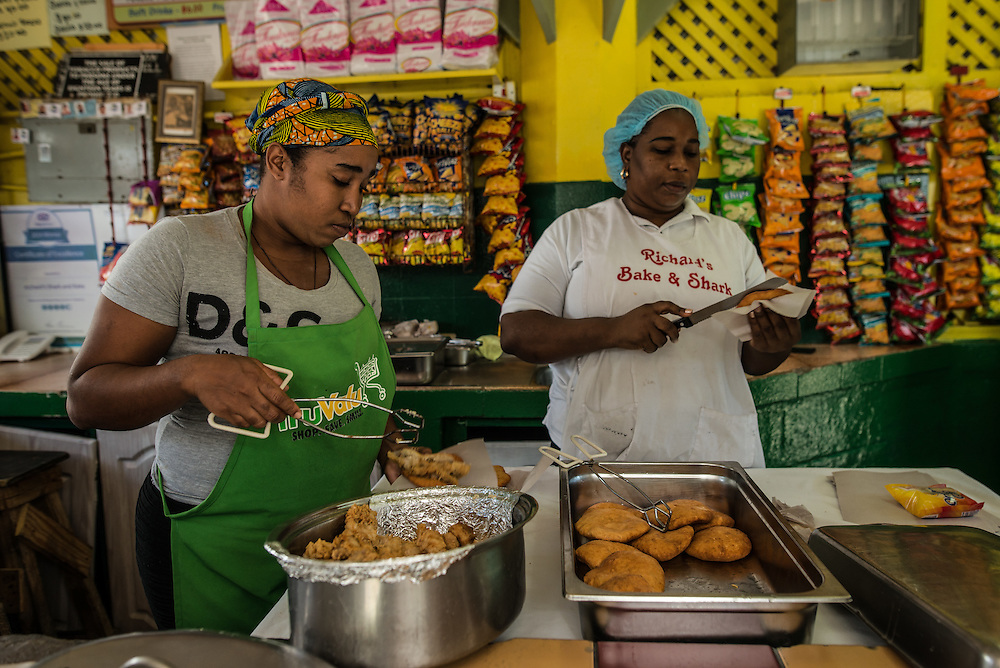 "MARACAS BAY, TRINIDAD - FEBRUARY 14, 2017:   Half the reason locals come to Maracas Bay is for the ""shark n' bake"" that's sold at a number of seaside food stands: a portion of hammerhead shark  battered and fried, then tucked into the ""bake"", a folded-over circle of freshly fried bread (30TT). Add a cold Carib beer to help you cool off. PHOTO: Meridith Kohut for The New York Times"