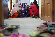 A collection of flipflops outside the entrance of a cafe meeting, organised and hosted for garment workers by Awaj Foundation, Dhaka, Bangladesh.<br /> <br /> Awaj Foundation was founded by Nazma Akter in 2003 to support and empower garment workers to negotiate safer and fairer working conditions in factories.