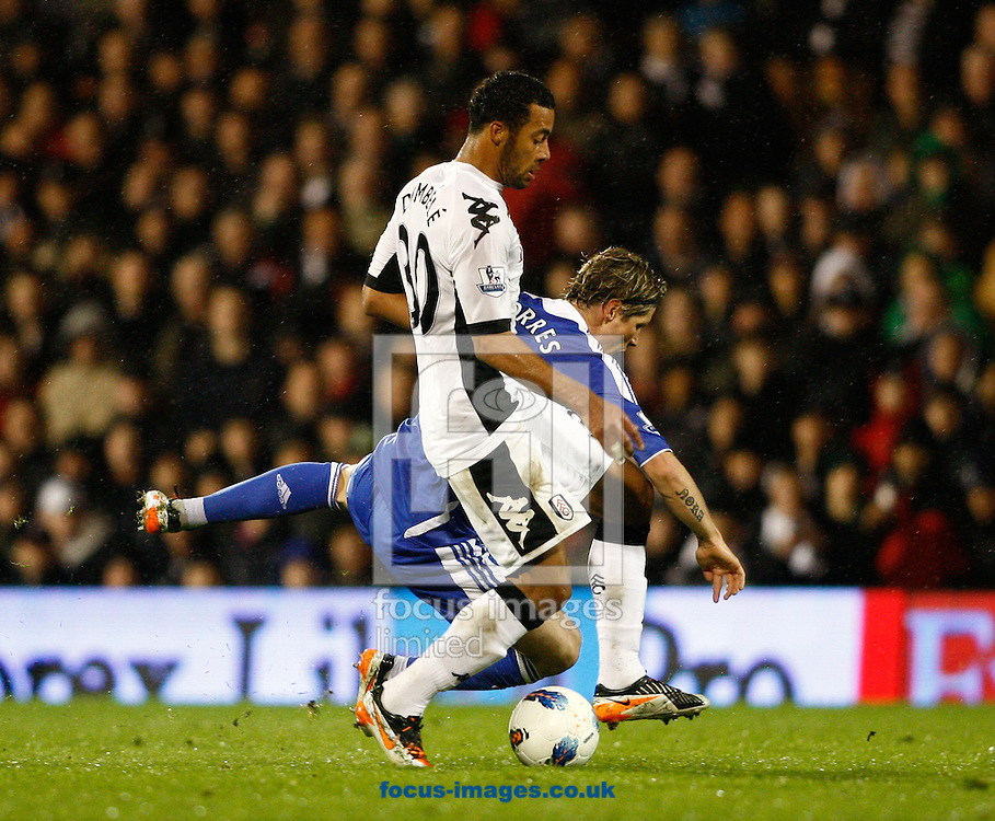 Picture by Andrew Tobin/Focus Images Ltd. 07710 761829. 09/04/12 Fernando Torres of Chelsea is tackled by Moussa Dembeleof Fulham during the during the Barclays Premier League match between Fulham and Chelsea at Craven Cottage stadium, London