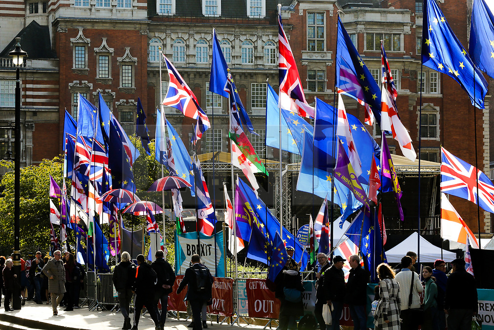 © Licensed to London News Pictures. 22/10/2019. London, UK. Flags flutter opposite The Houses of Parliament as MPs begin scrutinising Brexit Bill in the House of Commons. Photo credit: Dinendra Haria/LNP