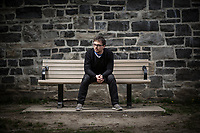 Robb Barnes, front man of Ottawa's The Pale Light, and Executive Director of Ecology Ottawa, sits on a park bench in the Hintonburg neighbourhood of Ottawa in May 2017 for some portrait photography.