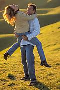 Happy couple in a grassy field