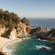 McWay Falls is in Pfeiffer Big Sur State Park in Monterey County, California near the town of Big Sur on the state's Central Coast. McWay Creek drops 80 ft. off a cliff onto the beach in an small cove along the Pacific Ocean. A trail in the park leads to an overlook where the cove and waterfall can be seen from above.   Access to the cove is restricted due to environmental concerns about the crumbly cliffs.  This stunning waterfall is well know for as it makes one feel like they have reached a beach in paradise with a waterfall gracefully dropping to the beach below.