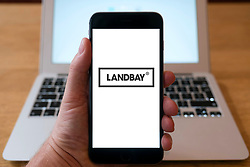 Landbay logo on  website on smart phone screen.