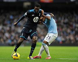 Tottenham Hotspur's Emmanuel Adebayor holds off Manchester City's Fernandinho - Photo mandatory by-line: Dougie Allward/JMP - Tel: Mobile: 07966 386802 24/11/2013 - SPORT - Football - Manchester - Etihad Stadium - Manchester City v Tottenham Hotspur - Barclays Premier League