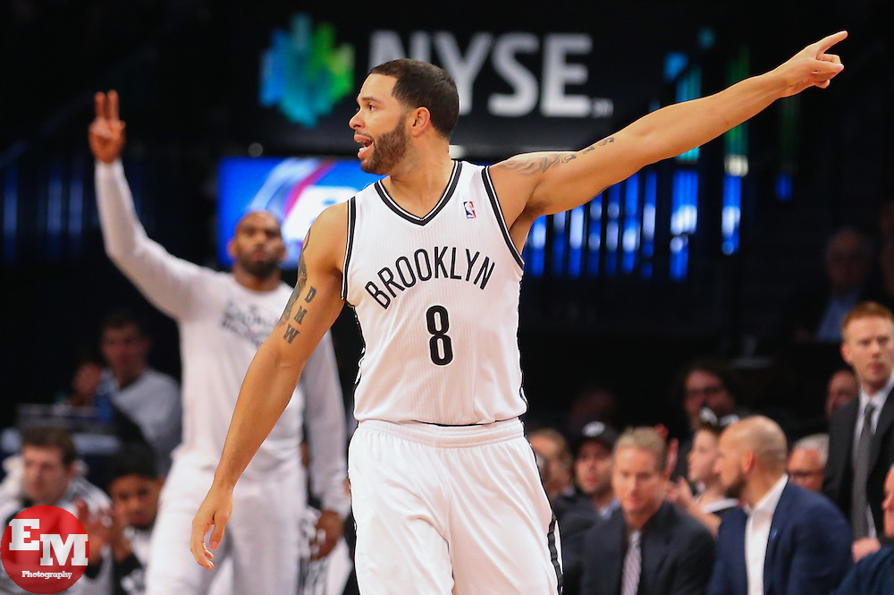Apr 1, 2014; Brooklyn, NY, USA; Brooklyn Nets guard Deron Williams (8) celebrates hitting a shot during the first quarter at Barclays Center.
