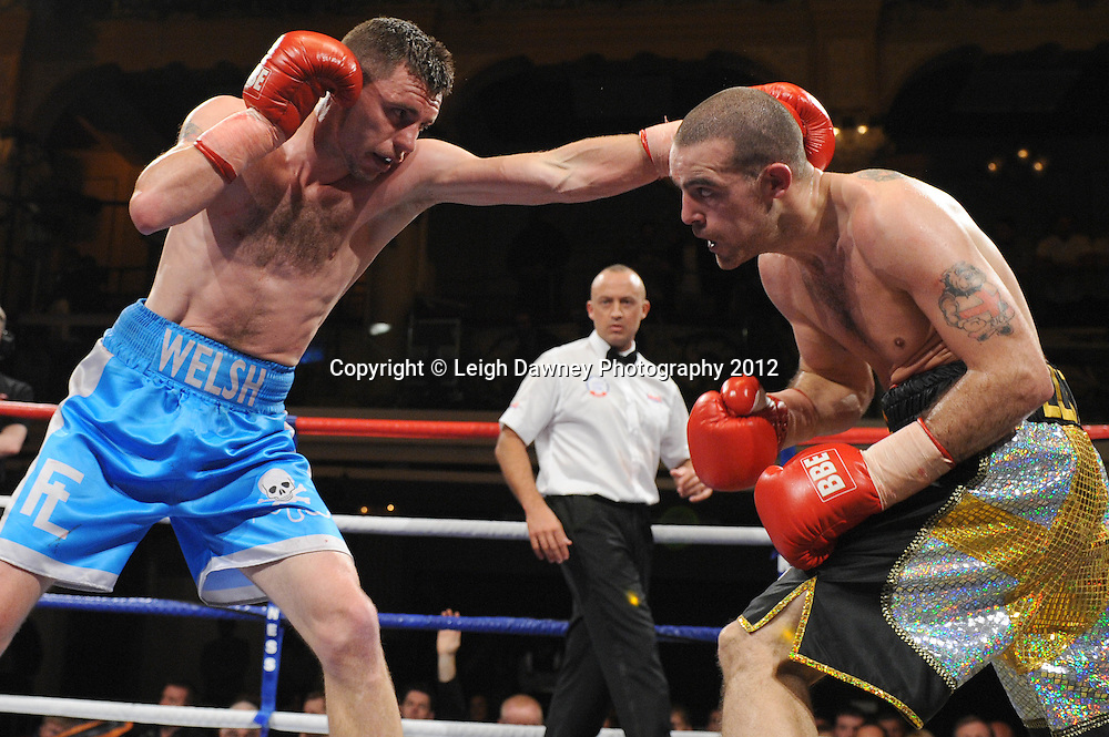 Martin Walsh (blue shorts) is disqualified and Rick Godding claims the Welterweight contest at The Winter Gardens, Blackpool on the 31st March 2012. Frank Maloney and Steve Wood VIP Promotions. © Leigh Dawney Photography 2012.
