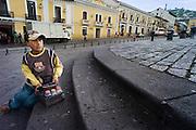 Shoeshine boy in Plaza San Francisco, Quito, Ecuador