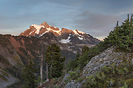 Sunset light on Mt. Shuksan from the Artist Point to Huntoon Point trail along Kulshan Ridge in Washington State's North Cascades Range. Photographed from Kulshan Ridge in the Mount Baker Wilderness. Mount Shuksan itself lies in North Cascades National Park.