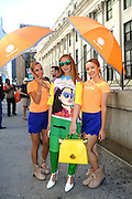 IMAGE DISTRIBUTED FOR ACCUWEATHER -  Alyson Cafiero is shaded from the hot summer sun by the AccuWeather MinuteCast street team at New York Fashion Week, on Tuesday, Sept. 15, 2015. The AccuWeather MinuteCast Street Team is at it again helping Fashion Week attendees stay stylish and one-step ahead of any possible precipitation. (Photo by Diane Bondareff/Invision for AccuWeather/AP Images)