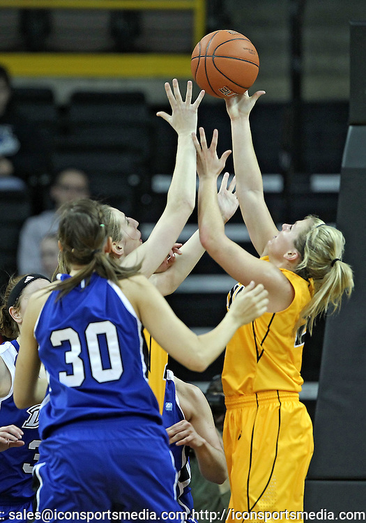 December 20, 2011: Iowa Hawkeyes forward Kelly Krei (20) and Iowa Hawkeyes guard Melissa Dixon (21) try to grab a rebound during the NCAA women's basketball game between the Drake Bulldogs and the Iowa Hawkeyes at Carver-Hawkeye Arena in Iowa City, Iowa on Tuesday, December 20, 2011. Iowa defeated Drake 71-46.