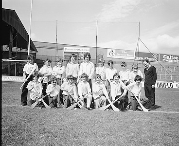 Children pose with hurls for a group photograph during their visit to Croke Park during a Kells Educational Tour on the 25th June 1976.