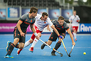 England's David Condon is tackled by Bjorn Kellerman and Bob de Voogd of the Netherlands. England v The Netherlands - Semi Final - Hockey World League Semi Final, Lee Valley Hockey and Tennis Centre, London, United Kingdom on 24 June 2017. Photo: Simon Parker