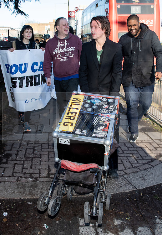 © Licensed to London News Pictures. 11/02/2019. London, UK. Lauri Love (C) arrives at Hendon Magistrates' Court. Love, an alleged hacker, is using the 'Police (Property) Act of 1897' to seek the return of his computers which were seized by police over five years ago. Last year, The High Court blocked Love's extradition to the United States. Photo credit : Tom Nicholson/LNP