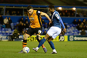 Birmingham City midfielder Jacques Maghoma tackles Hull City midfielder Robert Snodgrass during the Sky Bet Championship match between Birmingham City and Hull City at St Andrews, Birmingham, England on 3 March 2016. Photo by Alan Franklin.