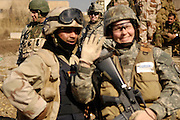 U.S. Army, Bravo Company, 1st Cavalry Division, 12th Infantry Regiment, and members of the Multi-Iraqi Transitional Team, 4th Battalion, 2nd Brigade, 5th Division, conduct a foot patrol in Buhriz, Iraq, on Feb. 17, 2007.  (U.S. Air Force photo by Staff Sgt. Stacy L. Pearsall) (Released)
