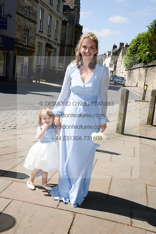 The brides sister LADY SYBILLA HART and her youngest daughter at the wedding of Lady Natasha Rufus Isaacs to Rupert Finch held at St.John The Baptist Church, Cirencester, Gloucestershire, UK on 8th June 2013.