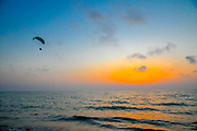 Paragliding over the Mediterranean Sea at sun set