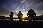 Idaho, near Sun Valley, Picabo, Silver Creek Preserve, Fly fishermen, summer, waiting for Brown Drake hatch, talking, sunset
