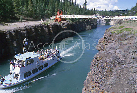 Alaska. Yukon. Whitehorse. Sternwheeler boat moves through Miles Canyon on the Yukon River.