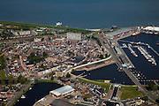 Nederland, Groningen, Delfzijl, 08-09-2009; overzichtfoto met rechts de zeehaven, links van de haven het centrum met het eemshotel op palen in het water van de Waddenzee.Overview Delfzijl with harbour.luchtfoto (toeslag); aerial photo (additional fee required); .foto/photo Siebe Swart
