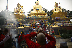 May 10, 2017 - Kathmandu, Nepal - A monk offers prayers in front of a gigantic idol of Buddha (C) during the 2561st birth anniversary of Buddha, also known as Buddha Jayanti or Vesak Day at Swambhu temple premise in Kathmandu, Nepal on Wednesday, May 10, 2017. (Credit Image: © Skanda Gautam via ZUMA Wire)
