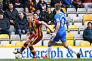 Bradford City midfielder Callum Guy (18) is closed down by Gillingham midfielder Jake Hessenthaler (8)  during the EFL Sky Bet League 1 match between Bradford City and Gillingham at the Northern Commercials Stadium, Bradford, England on 24 March 2018. Picture by Mick Atkins.
